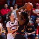 Nebraska's Rachel Theriot, left, guards Maryland's Laurin Mincy during an NCAA college basketball game at the Devaney Sports Center in Lincoln, Neb., Wednesday, Nov. 28, 2012. Maryland defeated Nebraska 90-71. (AP Photo/The Omaha World-Herald, Mark Davis)