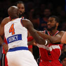 NEW YORK, NY - DECEMBER 25: Quincy Acy #4 of the New York Knicks scuffle with John Wall #2 of the Washington Wizards in the second half of their game at Madison Square Garden on December 25, 2014 in New York City. (Photo by Jeff Zelevansky/Getty Images)
