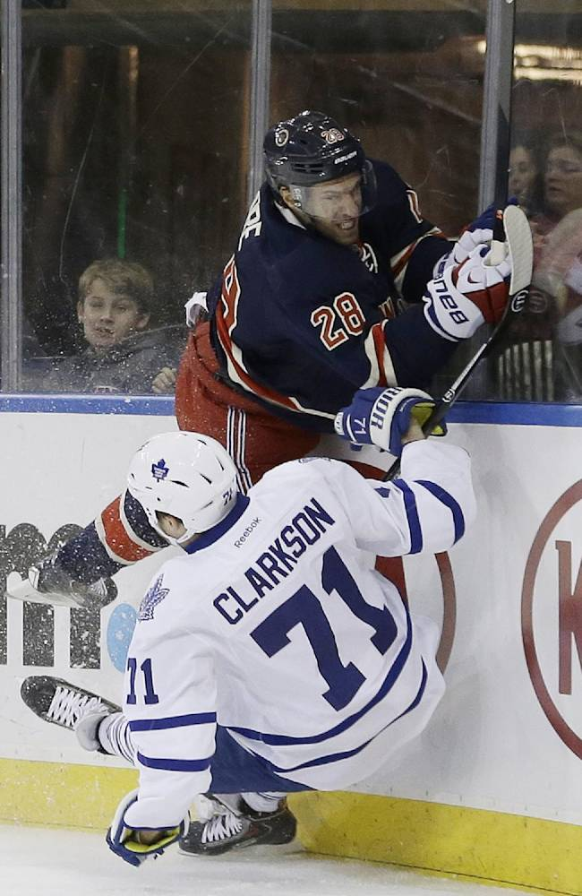 New York Rangers' Dominic Moore (28) checks Toronto Maple Leafs' David Clarkson (71) during the first period of an NHL hockey game Wednesday, March 5, 2014, in New York
