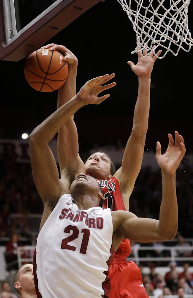 Arizona forward Aaron Gordon, top, blocks a layup attempt from Stanford forward Anthony Brown (21) during the second half of an NCAA college basketball game Wednesday, Jan. 29, 2014, in Stanford, Calif. Arizona won 60-57