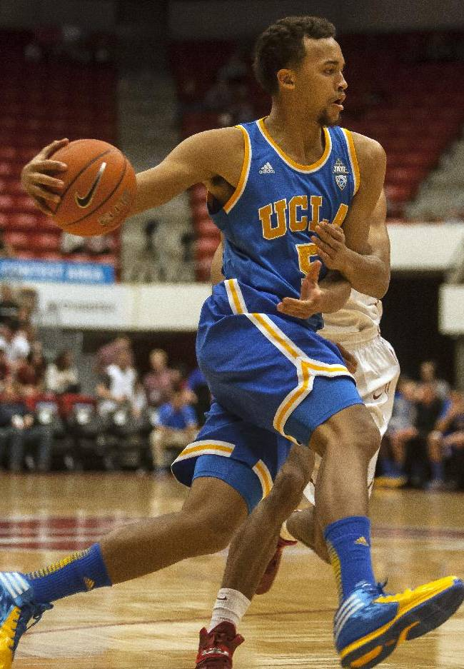 UCLA guard Kyle Anderson (5) drives against Washington State during the first half of an NCAA college basketball game Saturday, March 8, 2014, at Beasley Coliseum in Pullman, Wash