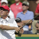 United States team captain�s assistant Davis Love III watches his tee shot on the eighth hole during a pra</td></tr>