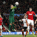 Donetsk's goalkeeper Andriy Pyatov, centre, punches the ball clear as Manchester United's Phil Jones, second right attempts to head the ball during their Champions League group A soccer match between Manchester United and Shakhtar Donetsk at Old Trafford