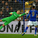 Manchester City's Joe Hart watches the ball go wide during the English Premier League soccer match between Leicester City and Manchester City at King Power Stadium, in Leicester, England, Saturday, Dec. 13, 2014