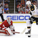 Detroit Red Wings goalie Jimmy Howard (35) stops a shot by Boston Bruins defenseman Zdeno Chara (33 in the third period of an NHL hockey game in Detroit, Wednesday, Oct. 15, 2014 The Associated Press