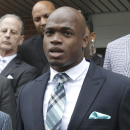 FILE - In this Nov. 4, 2014, file photo, Minnesota Vikings running back Adrian Peterson speaks to the media after pleading no contest to an assault charge in Conroe, Texas. The NFL suspended Adrian Peterson without pay for at least the remainder of the season. The league said Tuesday, Nov. 18, 2014, it informed the Minnesota Vikings running back he will not be considered for reinstatement before April 15 for violating the NFL personal conduct policy. (AP Photo/Pat Sullivan, File)
