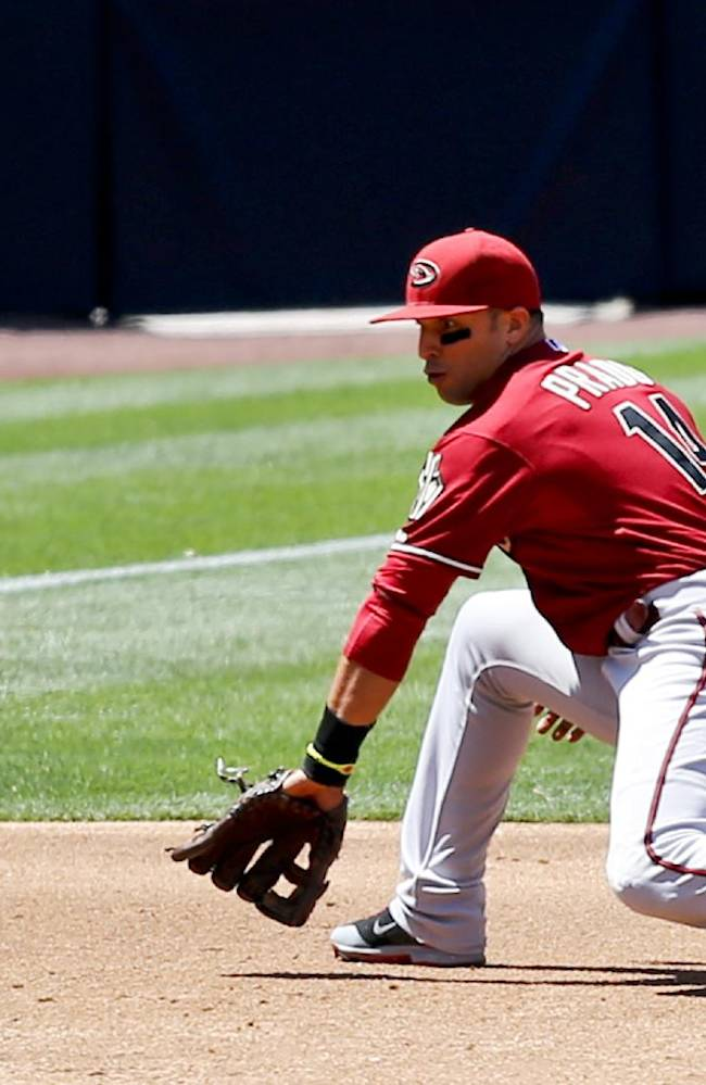 Arizona Diamondbacks third baseman Martin Prado makes the backhand stop on a hard grounder hit by San Diego Padres' Rene Rivera during the third inning of a baseball game won Sunday, May 4, 2014, in San Diego. Prado got the out at first