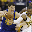 Golden State Warriors' Klay Thompson is defended by Indiana Pacers' C.J. Watson (32) during the second half of an NBA basketball game Tuesday, March 4, 2014, in Indianapolis. Golden State defeated Indiana 98-96 The Associated Press