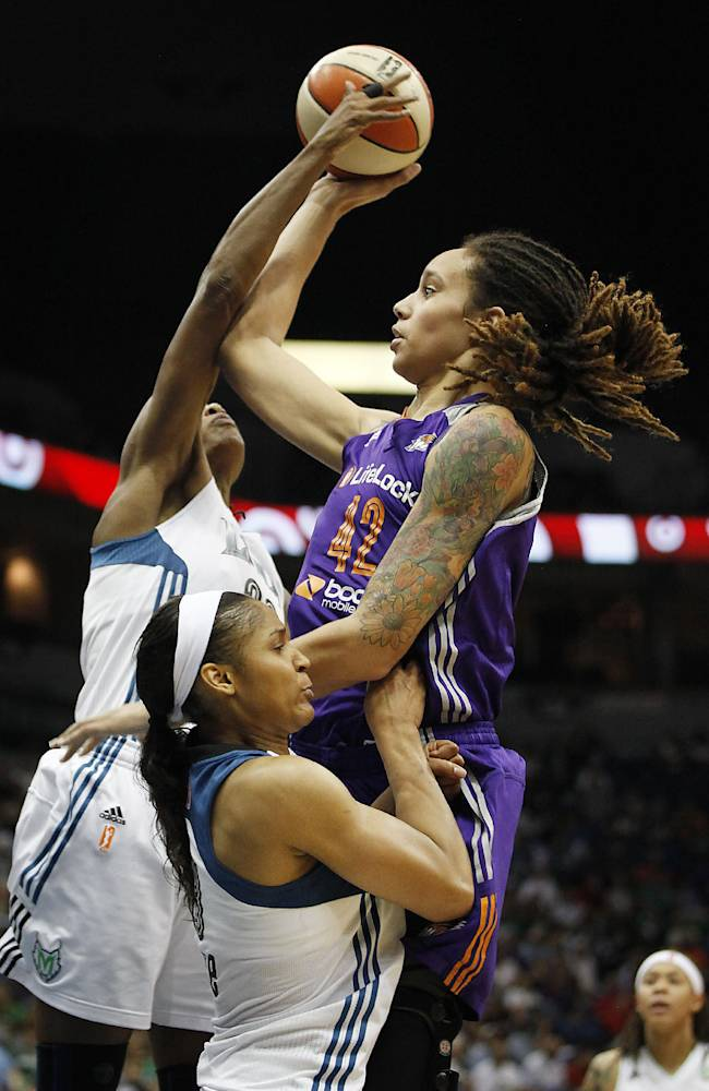 Phoenix Mercury center Brittney Griner (42) goes to the basket against Minnesota Lynx forward Rebekkah Brunson, left, and forward Maya Moore, bottom, during Game 1 of the WNBA basketball playoffs Western Conference finals on Thursday, Sept. 26, 2013, in Minneapolis. The Lynx won 85-62