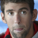 FILE - In this Aug. 20, 2014, file photo, U.S. swimmer Michael Phelps attends a press conference ahead of the Pan Pacific swimming championships in Gold Coast, Australia. Authorities say Phelps has been arrested on a DUI charge in Maryland. Transit police say they stopped the 29-year-old Phelps at the Fort McHenry Tunnel in Baltimore around 1:40 a.m. Tuesday, Sept. 30, 2014.(AP Photo/Rick Rycroft, File)