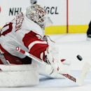 Detroit Red Wings' Jonas Gustavsson (50) turns away a shot on goal in the second period of an NHL hockey game against the Philadelphia Flyers, Saturday, Oct. 25, 2014, in Philadelphia The Associated Press