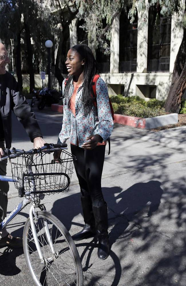 ADVANCE FOR WEEKEND EDITIONS, FEB. 22-23 - In this Feb. 19, 2014 photo, Chiney Ogwumike, a member of Stanford's NCAA college basketball team, talks to History professor Norman Naimark on the university's campus in Stanford, Calif