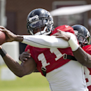 Atlanta Falcons wide receiver Julio Jones (11) catches a pass as wide receiver Harry Douglas (83) covers during an NFL football training camp Tuesday, July 29, 2014 in Flowery Branch, Ga The Associated Press