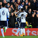 West Bromwich Albion's Victor Anichebe, center left, celebrates scoring his side's first goal of the game with teammates Saido Berahino, top, and Stephane Sessegnon during the FA Cup Fourth Round soccer match against Birmingham City at St Andrews, Birming