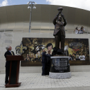 A statue of New Orleans Saints NFL football team owner Tom Benson is unveiled outside the Mercedes-Benz Superdome in New Orleans, Tuesday, Sept. 2, 2014. Looking on from left are Mark C. Romig, President and CEO of The New Orleans Tourism Marketing Corpor