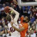 Syracuse guard Griffin Hoffmann (13) blocks a shot by Indiana forward Cody Zeller (40) during the second half of an East Regional semifinal in the NCAA college basketball tournament, Thursday, March 28, 2013, in Washington. (AP Photo/Pablo Martinez Monsivais)