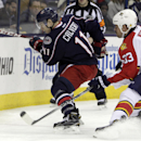 Columbus Blue Jackets' Matt Calvert, left, tries to clear the puck as Florida Panthers' Willie Mitchell defends during the second period of an NHL hockey game Monday, Dec. 1, 2014, in Columbus, Ohio The Associated Press
