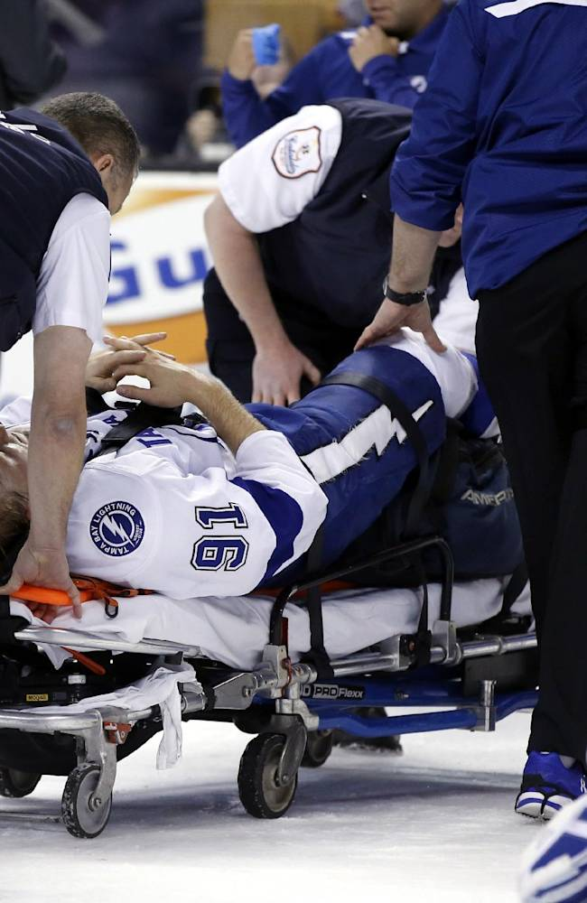 Tampa Bay Lightning center Steven Stamkos (91) is taken off the ice on a stretcher after slamming into the goalpost during the second period of an NHL hockey game against the Boston Bruins in Boston Monday, Nov. 11, 2013. The Lightning confirmed on the team's Twitter account that Stamkos suffered a broken right tibia