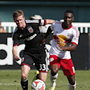 D.C. United defender Taylor Kemp (33) New York Red Bulls midfielder Lloyd Sam (10) run after the ball during the second half of an MLS soccer match, at RFK Stadium, Sunday, Aug. 31, 2014, in Washington. United won 2-0 The Associated Press