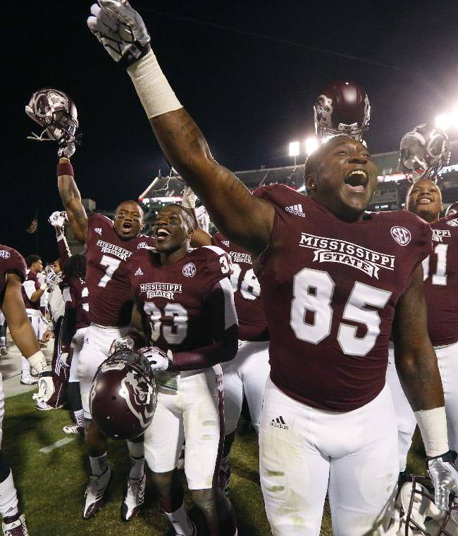 Mississippi State tight end Artimas Samuel (85) leads his teammates in celebrating  NCAA college football game win over Kentucky at Davis Wade Stadium in Starkville, Miss., Thursday, Oct. 24, 2013. Mississippi State won 28-22