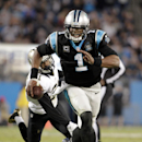 Carolina Panthers' Cam Newton (1) scrambles against the New Orleans Saints in the second half of an NFL football game in Charlotte, N.C., Thursday, Oct. 30, 2014 The Associated Press