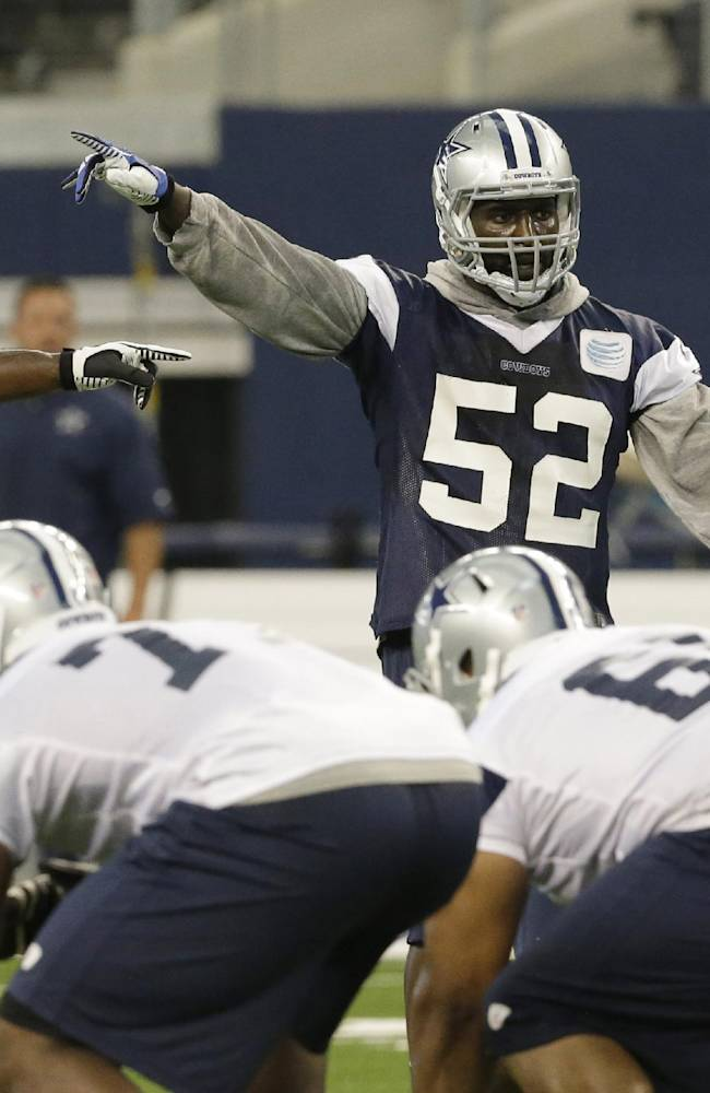 In this June 19, 2014, file photo, Dallas Cowboys outside linebackers Justin Durant (52) and Bruce Carter (54) line up during NFL football minicamp at the team's stadium in Arlington, Texas.  Durant, signed as a free agent last year, is the top in-house candidate to replace the injured  linebacker Sean Lee