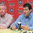 New Mexico men's basketball coach Steve Alford, right, announces he has accepted the job as UCLA coach, as New Mexico athletic director Paul Krebs listens during a news conference in Albuquerque, N.M., on Saturday, March 30, 2013. Alford said it was a difficult decision but that UCLA represents