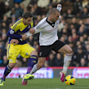 Fulham s PajtimKasami, fights for the ball with Swansea City s Angel Rangel, during their English Premier League soccer match, at the Craven Cottage stadium in London, Saturday, Nov. 23, 2013
