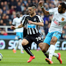 Newcastle United's Remy Cabella, left, vies for the ball with Hull City's Ahmed Elmohamady during their English Premier League soccer match at St James' Park, Newcastle, England, Saturday, Sept. 20, 2014