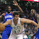 Boston Celtics center Kris Humphries (43) tries to break free from Philadelphia 76ers guard James Anderson, right, and forward Thaddeus Young, left, after grabbing a rebound during the first quarter of an NBA basketball game Friday, April 4, 2014, in Bost