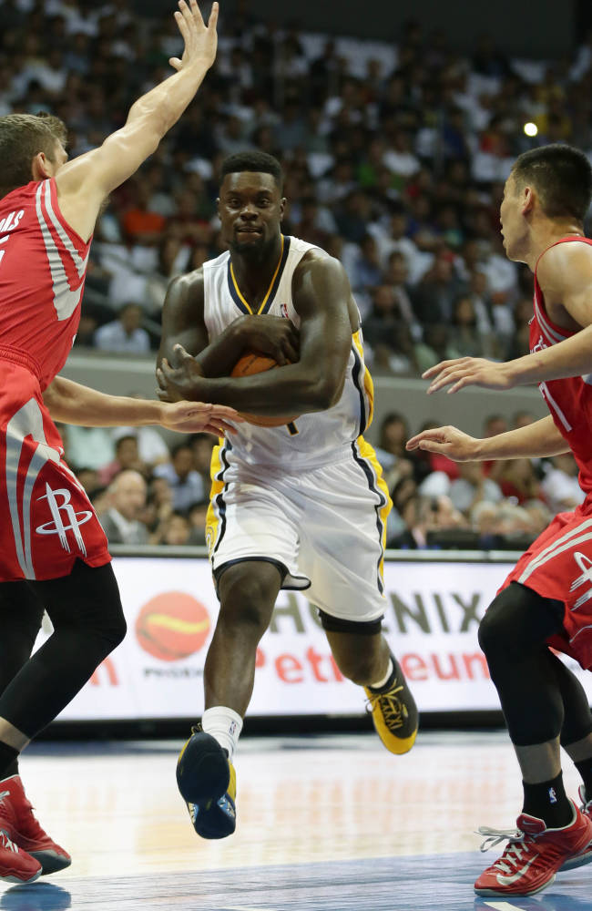 Indiana Pacers' Lance Stephenson, center, prepares to drive through the defense of Houston Rockets' Jeremy Lin, right, and Chandler Parsons during their NBA  pre-season game dubbed NBA Global Games Thursday Oct. 10, 2013, at the Mall of Asia Arena at suburban Pasay city, south of Manila, Philippines. The Rockets won 116-96, in the first NBA game in this basketball-crazy Southeast Asian nation which is part of the NBA's global schedule that will have eight teams play in six countries this month