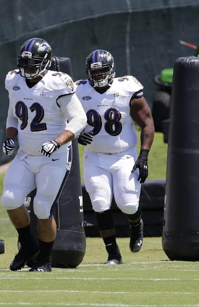 Baltimore Ravens nose tackle Haloti Ngata (92) jogs around obstacles during an NFL football training camp, Saturday, July 26, 2014, in Owings Mills, Md