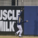San Diego Padres right fielder Seth Smith goes to the wall to capture a deep sacrifice fly by Cleveland Indians' David Murphy in the third inning of a spring exhibition baseball game at Friday, March 28, 2014, in San Diego The Associated Press