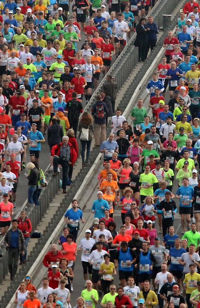 Thousands of athletes run shortly after the start of the Vienna city marathon, in Vienna, Austria, on Sunday, April 13, 2014