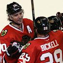 Chicago Blackhawks' Patrick Sharp (10), left, celebrates with Bryan Bickell (29) and Nick Leddy (8) after scoring the game-winning goal Montreal Canadiens during overtime period of an NHL hockey game in Chicago, Wednesday, April 9, 2014. The Blackhawks wo