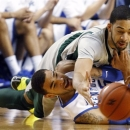 Eastern Michigan's Jamell Harris, top, and Kentucky's Willie Cauley-Stein go after a loose ball during the first half of an NCAA college basketball game at Rupp Arena in Lexington, Ky., Wednesday, Jan. 2, 2013. (AP Photo/James Crisp)