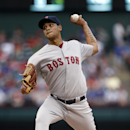 Boston Red Sox starting pitcher Eduardo Rodriguez works against the Texas Rangers during the first inning of a baseball game, Thursday, May 28, 2015, in Arlington, Texas. (AP Photo/Brandon Wade)