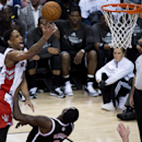 Toronto Raptors guard DeMar DeRozan, left, drives over Brooklyn Nets forward Andray Blatche to score during the second half of Game 2 in an NBA basketball first-round playoff series, Tuesday, April 22, 2014, in Toronto The Associated Press