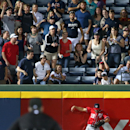 Washington Nationals center fielder Kevin Frandsen (19) crashes into the wall as he is unable to grab a solo home run hit by Atlanta Braves' Freddie Freeman in the eighth inning of a baseball game Saturday, April 12, 2014, in Atlanta. Atlanta won 6-3 The