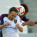 Real Salt Lake midfielder Ned Grabavoy, left, and Chivas USA defender Akira Kaji battle for the ball during the first half of a Major League Soccer match, Sunday, Oct. 5, 2014, in Carson, Calif The Associated Press