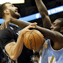 Minnesota Timberwolves' Nikola Pekovic, left, of Montenegro, gets tied up during a shot-attempt by Denver Nuggets's J.J. Hickson in the first quarter of an NBA basketball game on Wednesday, Nov. 27, 2013, in Minneapolis The Associated Press