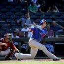 Chicago Cubs' Ryan Sweeney hits as Arizona Diamondbacks' Miguel Montero catches during the third inning of a spring training baseball game, Saturday, March 29, 2014, in Phoenix The Associated Press