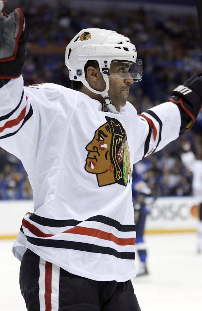 Chicago Blackhawks' Johnny Oduya, of Sweden, celebrates after scoring during the first period in Game 1 of a first-round NHL hockey Stanley Cup playoff series against the St. Louis Blues on Thursday, April 17, 2014, in St. Louis