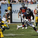 Chicago Bears wide receiver Alshon Jeffery (17) runs after catching a pass thrown by quarterback Jay Cutler in the first half of an NFL football game against the Green Bay Packers Sunday, Sept. 28, 2014, in Chicago. The Associated Press