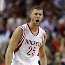 Houston Rockets' Chandler Parsons (25) reacts as teammate Jeremy Lin makes a free throw during overtime of an NBA basketball game Sunday, March 9, 2014, in Houston. The Rockets won in overtime 118-113 The Associated Press