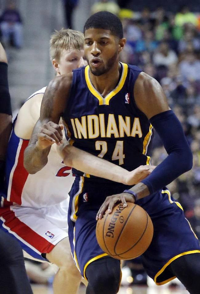 Detroit Pistons guard Kyle Singler (25) fouls Indiana Pacers forward Paul George (24) while trying to knock the ball away during the first half of an NBA basketball game Saturday, March 15, 2014, in Detroit. George led all players with 30 points in the Paers 112-104 overtime win