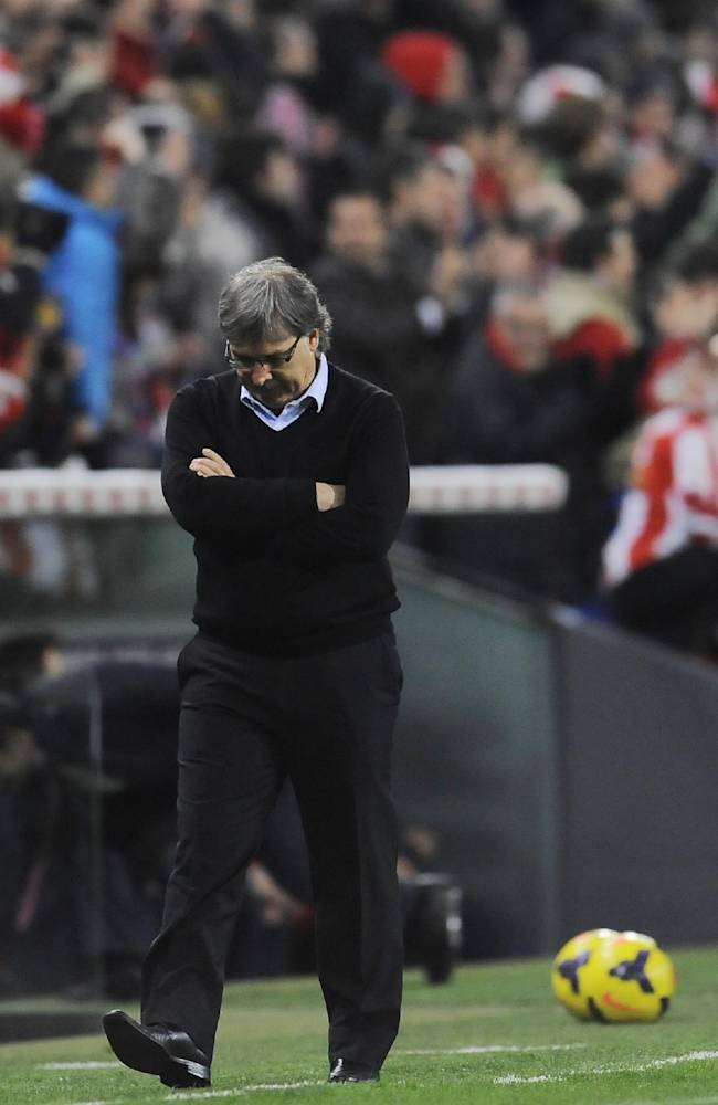 Barcelona's coach Gerardo Martino of Argentina, looks down after Athletic Bilbao scored during their Spanish League soccer match, at San Mames stadium in Bilbao, Spain, Sunday, Dec. 1, 2013