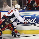 Florida Panthers' Scottie Upshall (19) and Washington Capitals' Nicklas Backstrom (19) vie for the puck during the first period of an NHL hockey game, Thursday, Feb. 27, 2014, in Sunrise, Fla The Associated Press