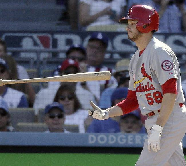 St. Louis Cardinals' Joe Kelly flips his bat after striking out during the fifth inning of Game 5 of the National League baseball championship series against the Los Angeles Dodgers Wednesday, Oct. 16, 2013, in Los Angeles