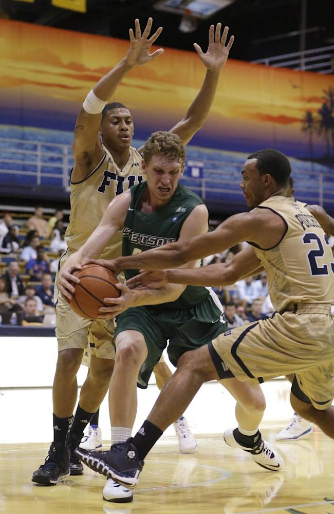 Stetson center Kyle Sikora, center, attempts to keep possession of the ball as he is guarded by Florida International forward Jerome Frink, left, and guard Marco Porcher Jimenez during the first half of an NCAA college basketball game, Monday, Nov. 18, 2013 in Miami